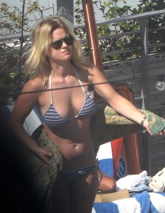 English actress Alice Eve sunbathing at the pool in Miami Beach Non Exclusive.