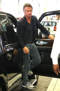 A tired looking Sean Penn departing Miami Int Airport Exclusive
