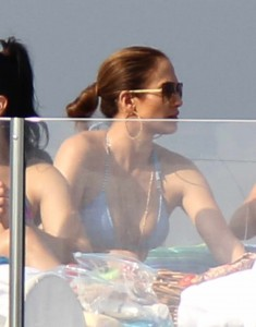 Jennifer Lopez on a yacht with family suntanning. Non Exclusive