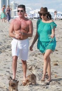Simon Cowell and Lauren Silverman take pets to the beach in Miami.