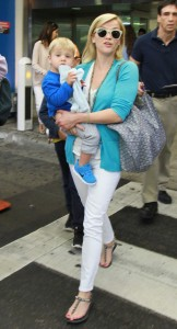 Reese Witherspoon and kids arrives at Miami International Airport.