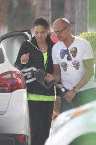 Adriana Lima gets help at the pump from mystery man in Miami.
