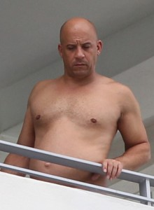 Actor Vin Diesel showing his pectorals in a balcony in Miami Beach.