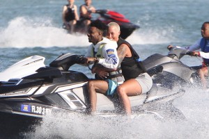Model and actress Amber Rose showing some PDA with boyfriend rapper 21 Savage while riding a jet ski in Miami