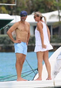 Singer Chayanne displaying his abs with wife Marilisa at the Haulover sandbar in Miami