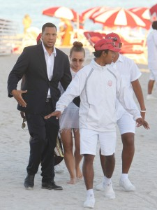 Chloe Green gets all the protection she can while vacationing in Miami Beach with boyfriend.