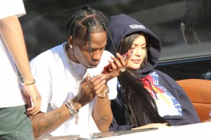 Kylie Jenner and her baby daddy Travis Scott took time off baby duty for a  cruise with pals in Miami two weeks after giving birth .