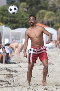 German professional footballer Karim Bellarabi swimming and playing with friends in Miami Beach