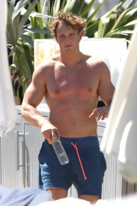 American social media personality Logan Paul displaying his abs shirtless and poolside in Miami Beach.