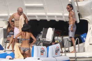 Latin singer, songwriter and actor Marc Anthony shirtless with new girlfriend Italian model Miss Curvy Italia 2011 Raffaella Modugno in a bathing suit aboard yacht during Labor Day Weekend in Miami.