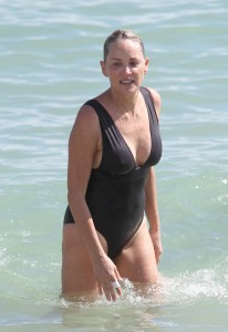 Sharon Stone takes a soft landing while trying to climb out of the steep sand after  swimming at the beach in Miami